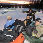 Friends tubing down the Mega Snow Coaster
